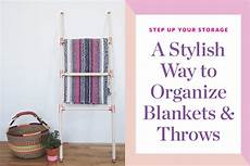 two cheerful apartments with creative storage and splashes of step up your storage my favorite way to organize blankets