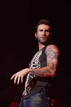 adam levine s tattoos ranked metrolyrics