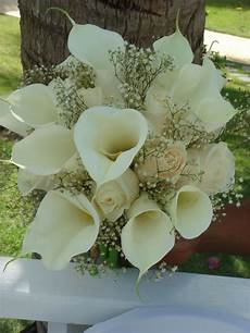 bouquet bridal white calla lilies roses and baby s breath bouquet