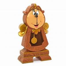 lumiere la e la bestia cogsworth pendulum clock disney parks collection
