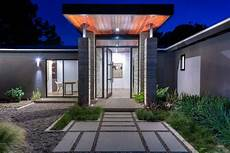 4 homes using concrete as a stylish modern ranch style home with concrete paver walkway hgtv