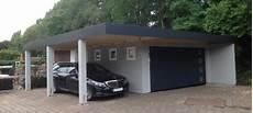 garage innen mit holz doppelcarport typ massiv mit abstellraum im massiv look