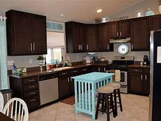 espresso cabinets love the little table as island kitchen cabinet colors kitchen cabinets