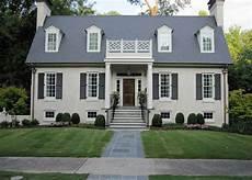 beige dormer grey home modern house