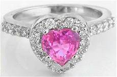 platinum diamond halo engagement ring with heart shape pink sapphire and matching wedding band