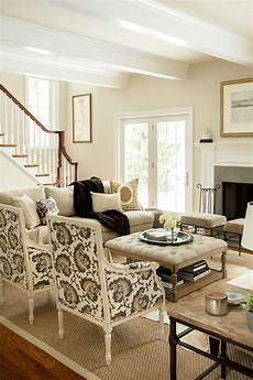 facing living room neutral living room hip traditional large scale print on