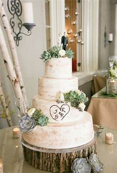 rustic wedding cake with succulents brides