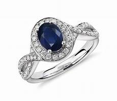 sapphire and diamond halo twist ring in 14k white gold