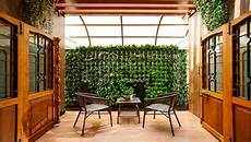 modern glass house open landscaping decorations outside space with wall garden and glass top table with