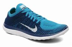 nike nike free 4 0 flyknit sport shoes in blue at sarenza