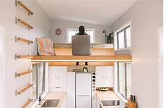 loft design for a family that makes clever use of its tiny house on wheels with a floating office study loft