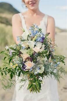 a wild blue bridal bouquet for a beach wedding chic