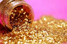 bottle of spilled gold glitter photo by mccutcheon