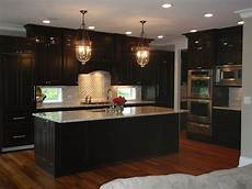wood floor with dark cabinets black kitchen cabinets kitchen cabinet design black kitchens