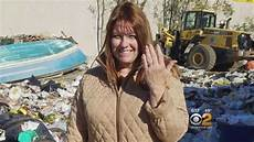 combs through piles of trash at town dump to find
