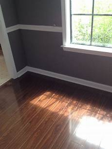 Seal Gray Paint With White Trim And Laminate Floor