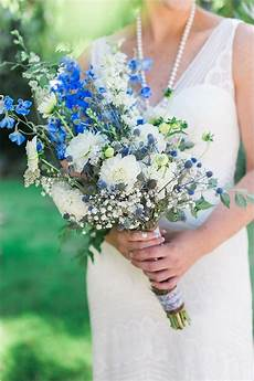 blue and white wedding bouquet by stemm floral deer pearl flowers