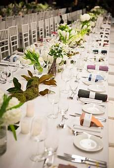 long banquet table with white and green centerpieces at australia s museum of contemporary art