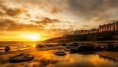 Foto Pemandangan Matahari Terbenam Di Pantai Gambar Viral Hd