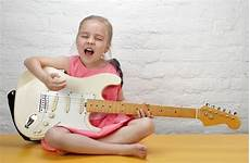 guitar and singing how to sing and play guitar at the same time