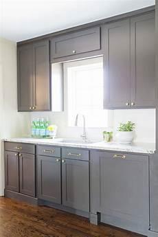 davis interiors bianco toscana granite cabinet color urbane bronze by sherwin williams