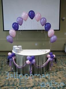 air balloon baby shower cake decorated table with adorned balloon puffballs and