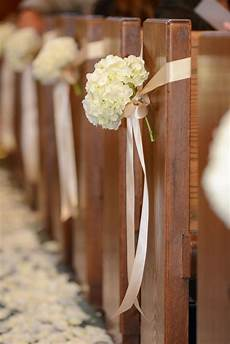 the church pews will have single stems of white hydrangea tied to the pews with loose blush