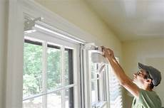 installing white faux wood window blinds house