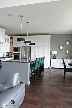open layout white kitch with gray painted island teal accents sherwin williams dorian gray
