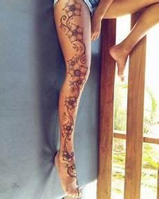 Bein Tattoos Frauen - blumen tribal frau bein blumenranken
