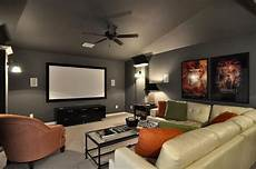 i like the gray walls in this media room with the pop of