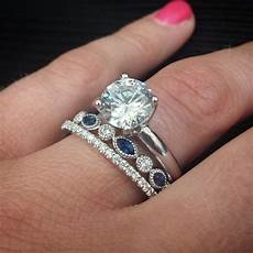 diamond and blue sapphire wedding band looks amazing between a pave diamond wedding band