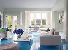 cococozy design idea white walls blue floor living room color