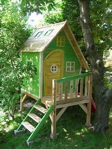 Kinderspielhaus Garten Holz - kinderspielhaus stelzenhaus aus holz mit rutsche