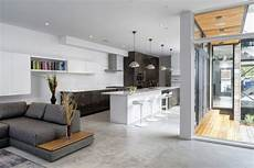 an open floorplan highlights a minimalist minimalist ottawa residence interiors out of a barn