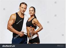 fitness male and female athletic man and woman after fitness exercise stock photo