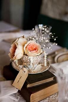 teacup centrepiece using vintage books and handmade tags i up and styled these
