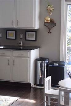 white cabinets light gray walls dark gray countertops black stainless steel appliances