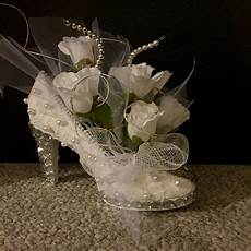 recycled thrift store shoe flower arrangement centerpiece