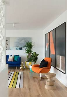 a 60s inspired apartment with a creative layout and upbeat 60s inspired apartment contemporary living room