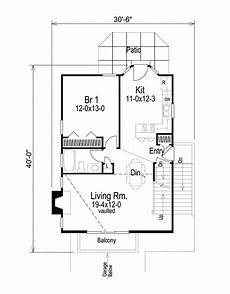 sloped land house plans compact home plan for sloping lot 57026ha