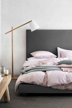 mixed linen in the bedroom soft pink and greys by h m