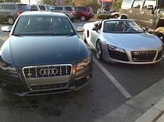 my 2011 audi s4 next to an audi r8 v10 audi
