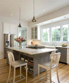 Kitchen Island With Seating Toronto by Open And Airy Kitchen With Seating Around A Cooktop