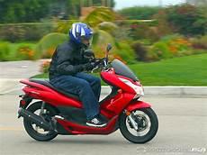 2011 honda pcx 125 ride photos motorcycle usa