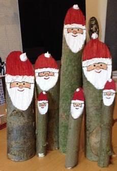 weihnachtsmänner aus holz selber machen weihnachtsmann baumstamm nikolaus aus holz deko in baden
