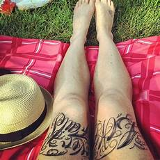 lettering tattoos on both thigh