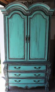 aqua turquoise french armoire with aged copper patina accents doing this on a painting