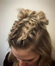 double braids finished into buns for this cute