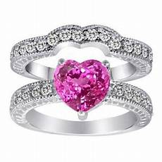 pink heart shape engagement ring i would change the color to blue or something not into the